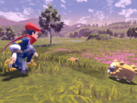 A young man faces a young, rodent-like creature in a grassland approaching from the right of the frame.