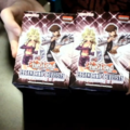 A man holds two boxes of trading cards