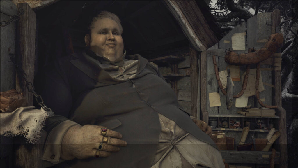 A large, obese man sits in a cart looking upon and smiling at the the viewer. Behind him, one of the cart's doors is ajar, displaying various items.